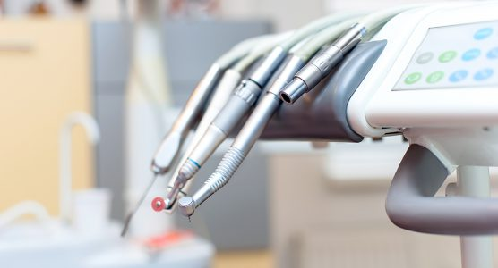 Dental tools on dentist chair with medical equipment and new technology